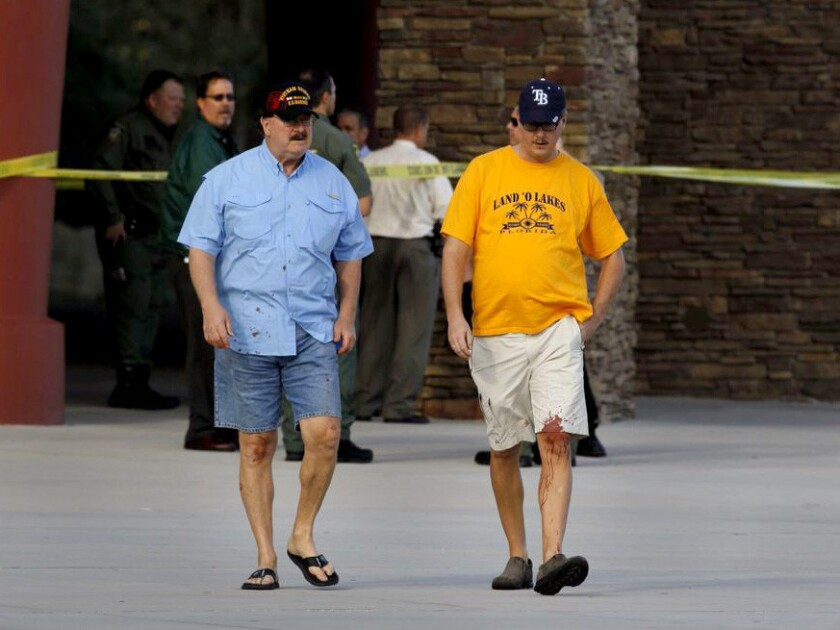 Charles Cummings, 68, left, and his son Alex, 34, witnessed the shooting inside the Cobb Grove 16 theater in Wesley Chapel, Fla., on Monday.