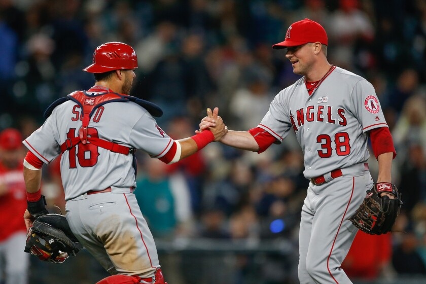 Geovany Soto, left, congratulates Joe Smith after an Angels win over Seattle on May 15.