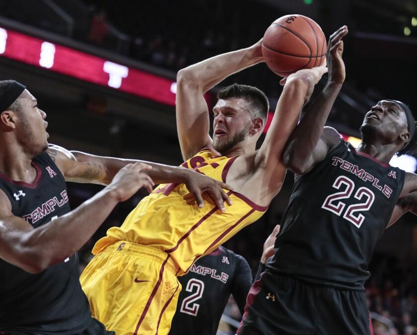 USC's Nick Rakocevic battles Temple's De'Vondre Perry for a rebound Friday night at Galen Center.