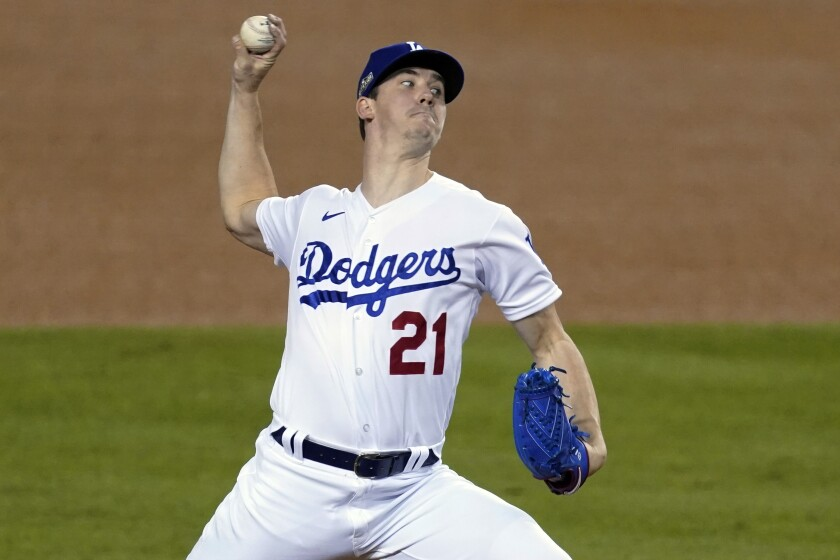 Dodgers starting pitcher Walker Buehler throws during a playoff win over the Milwaukee Brewers.