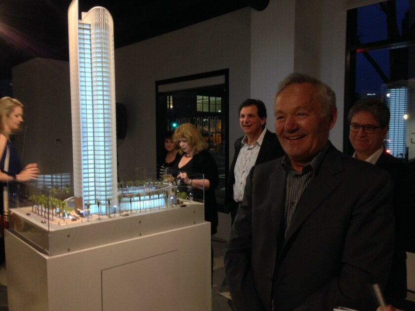 Nat Bosa (foreground, at right) reviews the model of his Pacific Gate project at the sales office.