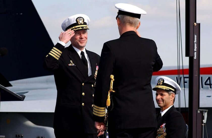 Capt. Ted Branch, left, relieves Capt. Bob Gilman as commanding officer of USS Nimitz (CVN 68), during a change of command ceremony in 2004.