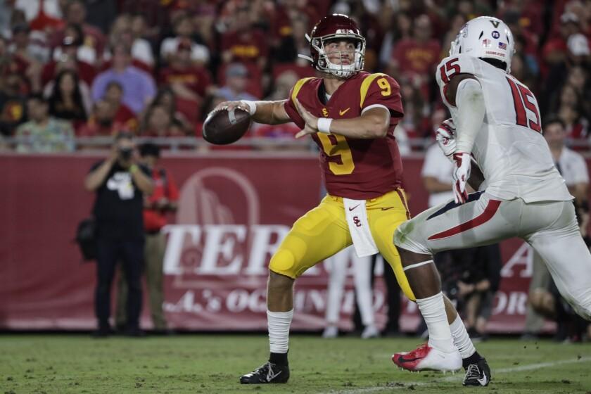 USC quarterback Kedon Slovis prepares to throw a pass against Fresno State at the Coliseum on Aug. 31.
