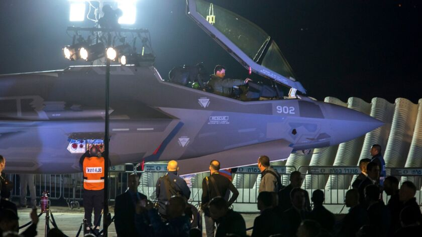 A Lockheed F-35 jet fighter arrives for delivery in Israel on Monday, just as Donald Trump was tweeting a complaint about the plane's cost overruns back in the U.S.