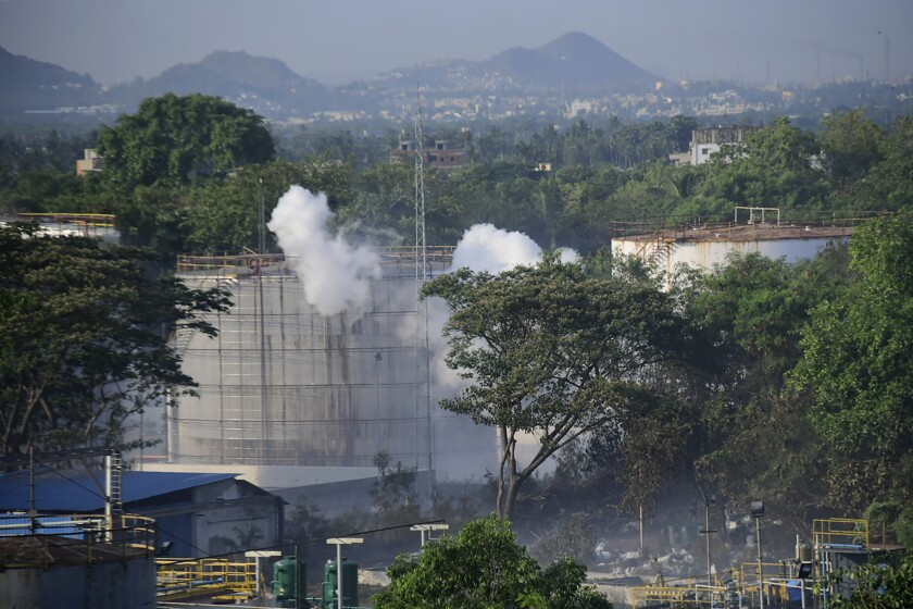 Smoke rises from the LG Polymers plant, the site of a chemical gas leakage, in Vishakhapatnam, India, on May 7, 2020.