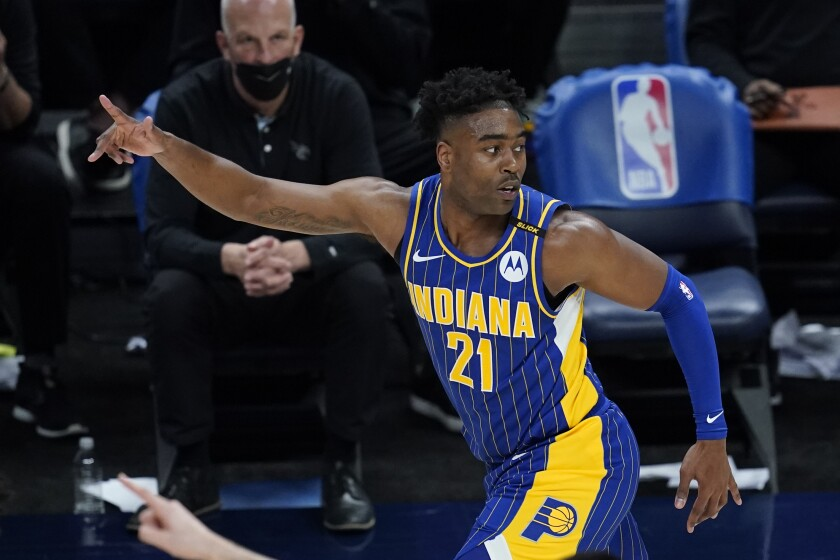 Indiana Pacers' Kelan Martin reacts after hitting a shot during the second half of the team's NBA basketball Eastern Conference play-in game against the Charlotte Hornets, Tuesday, May 18, 2021, in Indianapolis. Indiana won 144-117. (AP Photo/Darron Cummings)