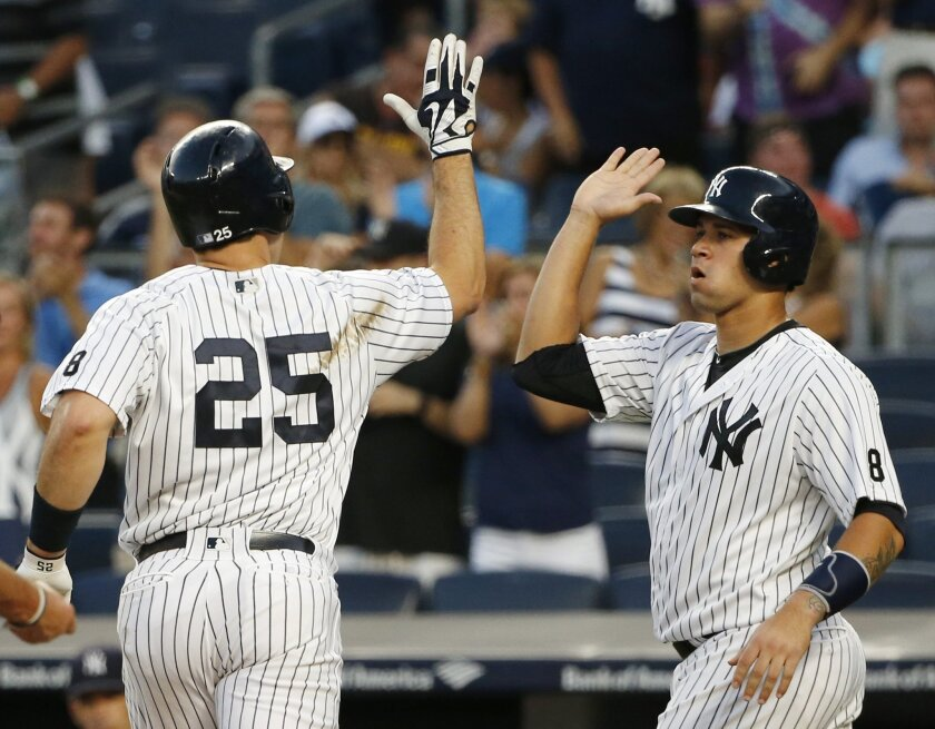 New York Yankees' Gary Sanchez, right, greets Mark Teixeira after scoring on Teixeira's first-inning, two-run home run in a baseball game against the Baltimore Orioles in New York, Friday, Aug. 26, 2016. (AP Photo/Kathy Willens)