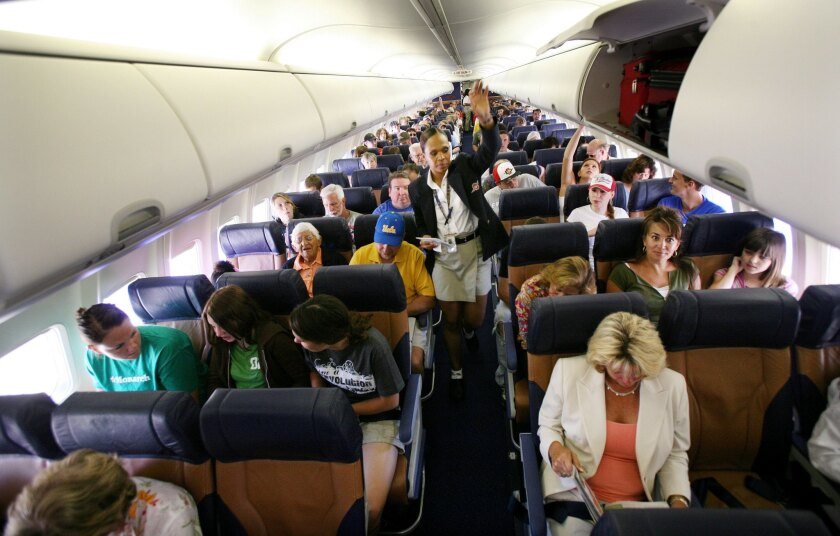 Airlines are improving fuel efficiency by squeezing more passengers into cabins, according to a new study. Above, passengers prepare for takeoff on a Southwest Airlines flight from San Diego's Lindbergh Field.