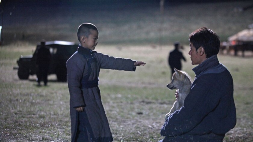 """Shaofeng Feng, right, in """"Wolf Totem."""""""