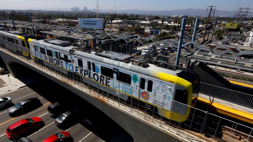 An Expo Line train cuts across traffic on La Cienega boulevard, heading east toward downtown Los Angeles.