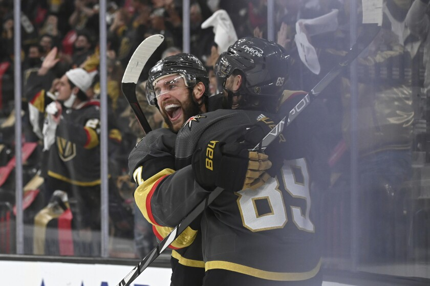 Vegas Golden Knights defenseman Alex Pietrangelo (7) and right wing Alex Tuch (89) celebrate Tuch's goal against the Minnesota Wild during the second period of Game 2 of a first-round NHL hockey playoff series Tuesday, May 18, 2021, in Las Vegas. (AP Photo/David Becker)