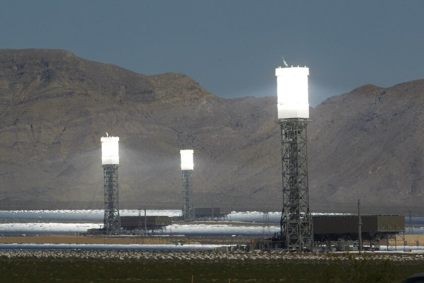 California is tapping desert sunlight from remote locations to satisfy energy needs. Boiler towers glow at the Ivanpah Solar Project in California's Mojave Desert.