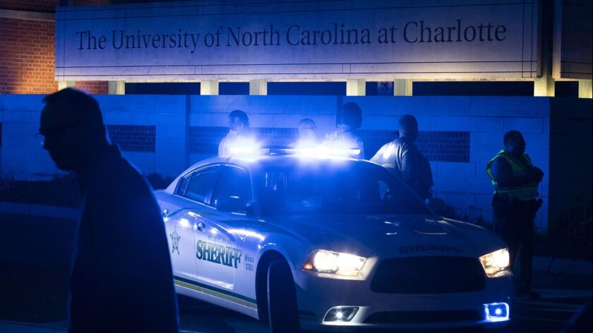 Police secure the main entrance to the University of North Carolina on Tuesday.