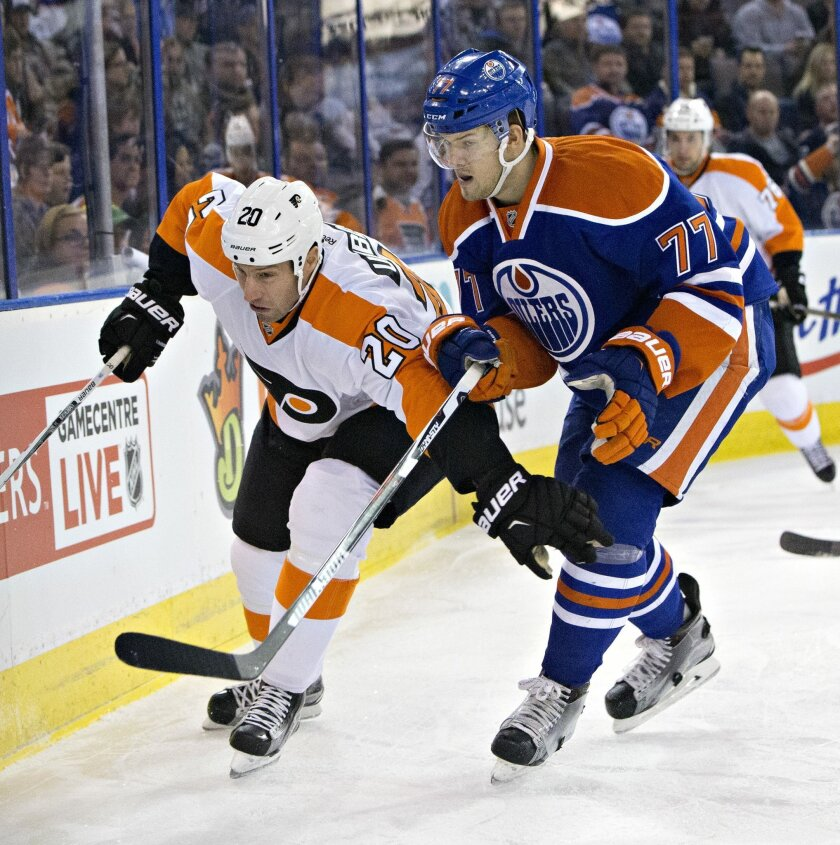 Philadelphia Flyers' R.J. Umberger (20), left, and Edmonton Oilers' Oscar Klefbom (77) vie for the puck during the first period of an NHL hockey game in Edmonton, Alberta, Tuesday, Nov. 3, 2015. (Jason Franson/The Canadian Press via AP) MANDATORY CREDIT