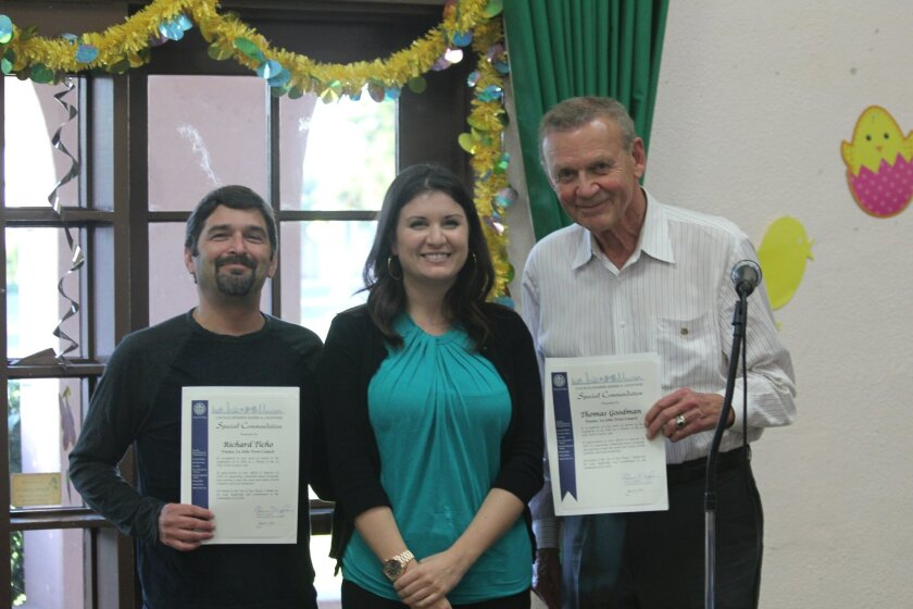Alison Don with City Council President Sherri Lightner's office, presents commendations to trustees Tom Goodman (right) and Richard Ticho for their service. Both are exiting the board after serving the remaining terms of members who stepped down.