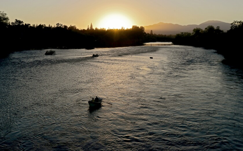 Fishermen ply the waters of the Sacramento River near Redding in October.