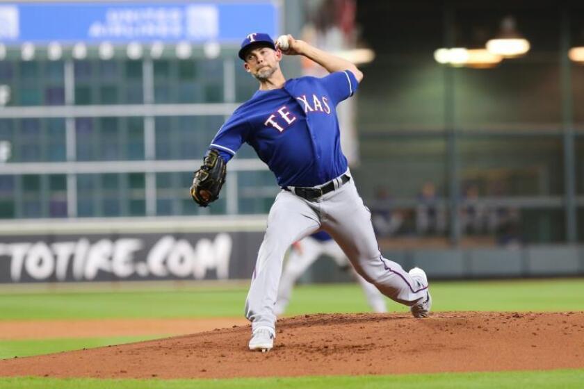 En la imagen, el jugador Mike Minor de los Vigilantes de Texas. EFE/Jorge Campos/Archivo