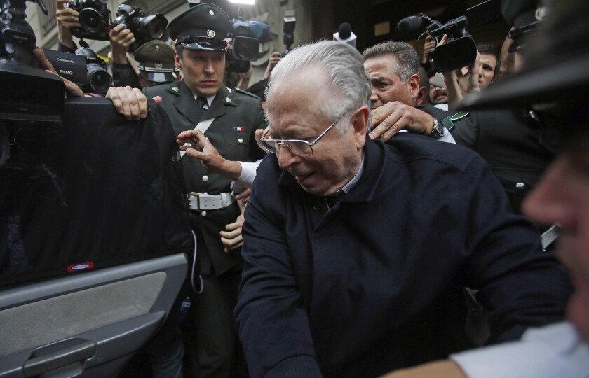 Fernando Karadima is escorted from court in 2015 in Santiago, Chile.