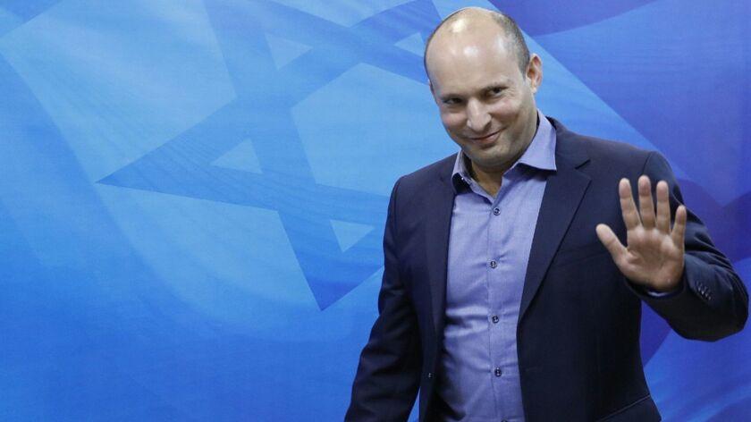 Israeli Education Minister Naftali Bennett arrives for the weekly Cabinet meeting at the prime minister's office in Jerusalem on Nov. 18.