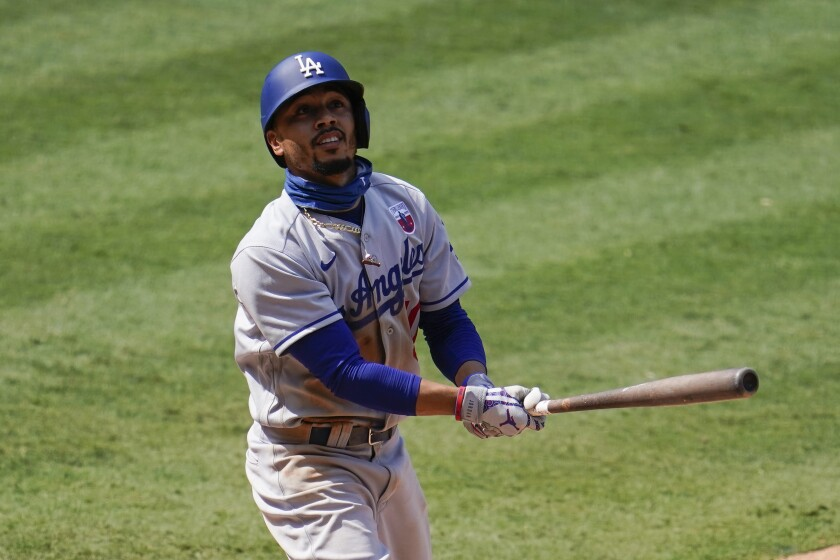 Los Angeles Dodgers' Mookie Betts hits a baseball foul.
