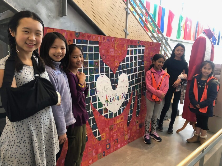 Solana Ranch students Alethia Li, Anita Qian, Maggie Liang (fifth-graders), Anaya Lalani (second grade), Isabel Ji (fifth grade) and Emi Diep (second grade) with their Kindness Challenge art project. Art instructor Gini Mann-Deibert guided students as they made individual squares to create a kindness mosaic.