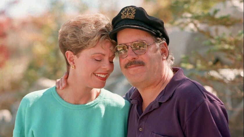 Toni Tennille, left, and Daryl Dragon in 1995. Dragon died Wednesday at 76.