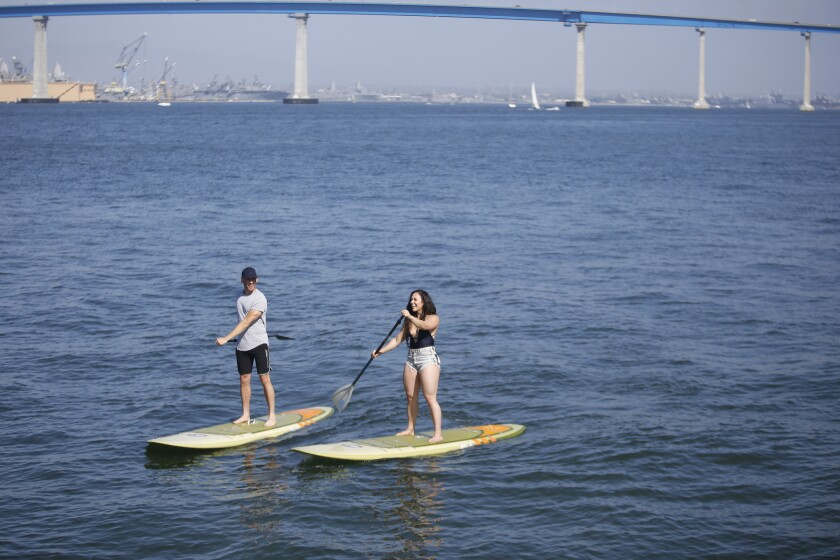 Pacifc Magazine's Blind Daters Kyle and Alyssa on stand-up paddle boards