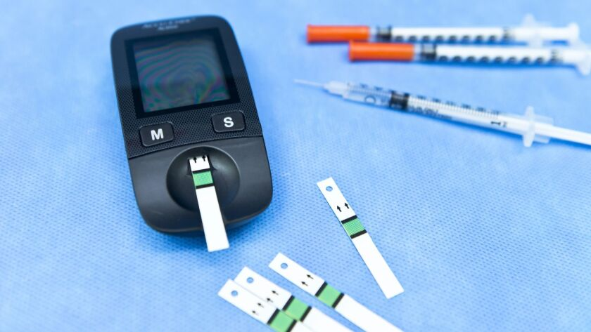 Small blood glucose meter, test strips, and insullin syringe for patients