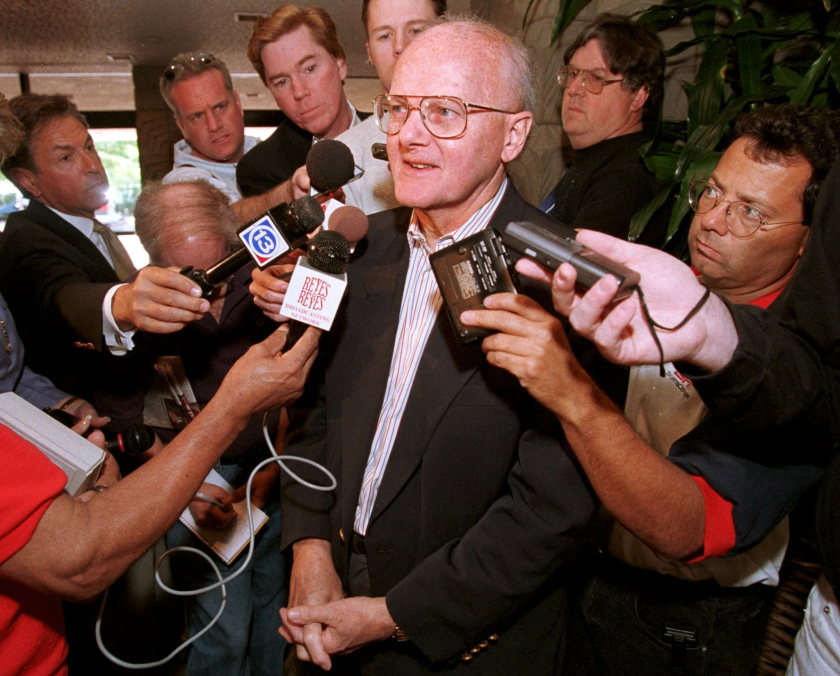 Kansas City Chiefs owner Lamar Hunt speaks to reporters at the NFL's annual meeting in March 1999.