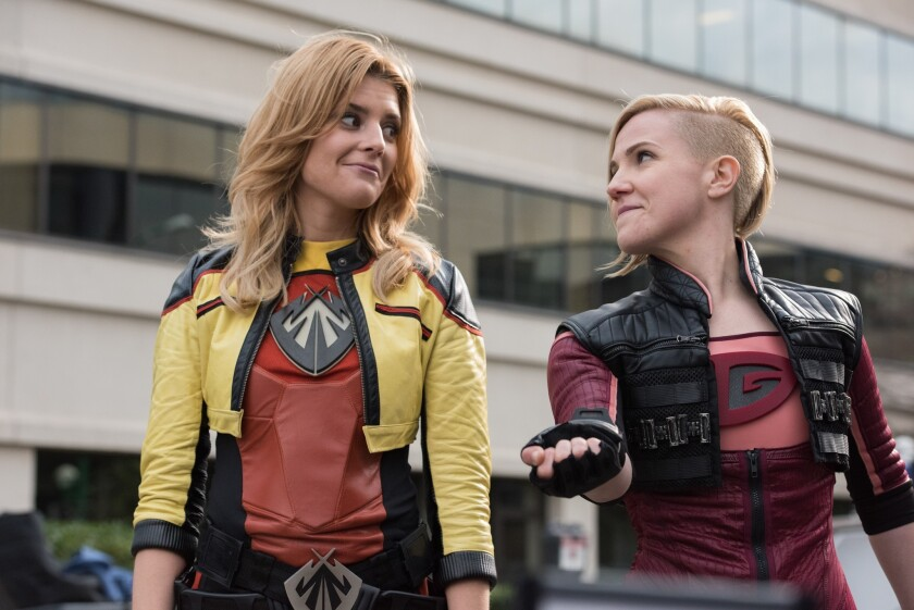 """Grace Helbig as Electra Woman and Hannah Hart as Dyna Girl in """"Electra Woman & Dyna Girl."""" The series will be available on Fullscreen's subscription video service that launches next month"""