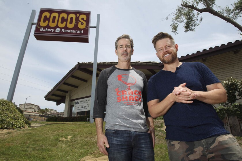 Partners Michael Rosen, left, and Ricard Blais, stand outside the former Coco's restaurant, which will be the location of their new all day chicken and egg restaurant in Encinitas, called the Crack Shack, on Encinitas Boulevard.