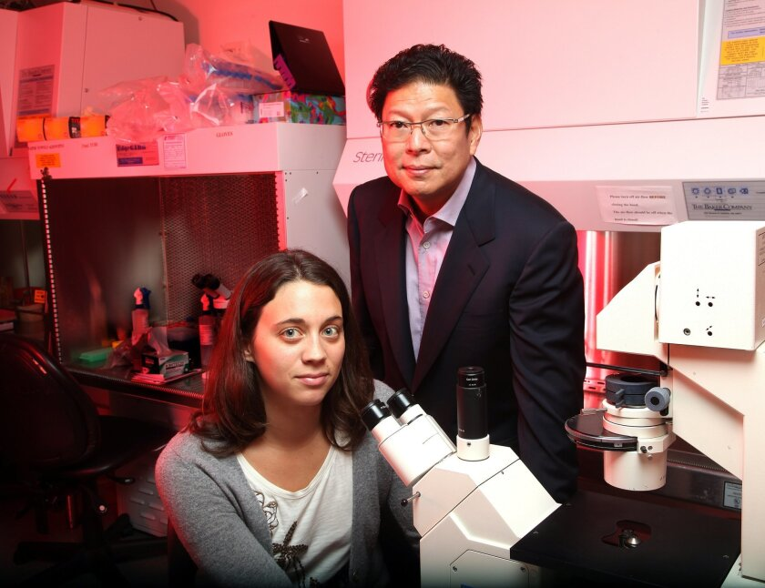 Dr. Jerold Chun, professor of molecular and cellular neuroscience at The Scripps Research Institute, has found that brain cells in people with Alzheimer's disease have different DNA compositions. Here he stands next to Gwen Kaeser, a graduate student and co-first author of a new study on this disco