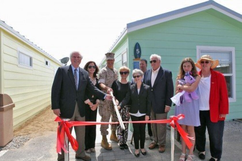 Donors and project participants take part in a ribbon-cutting ceremony for the vacation cottages at Camp Pendleton. Courtesy