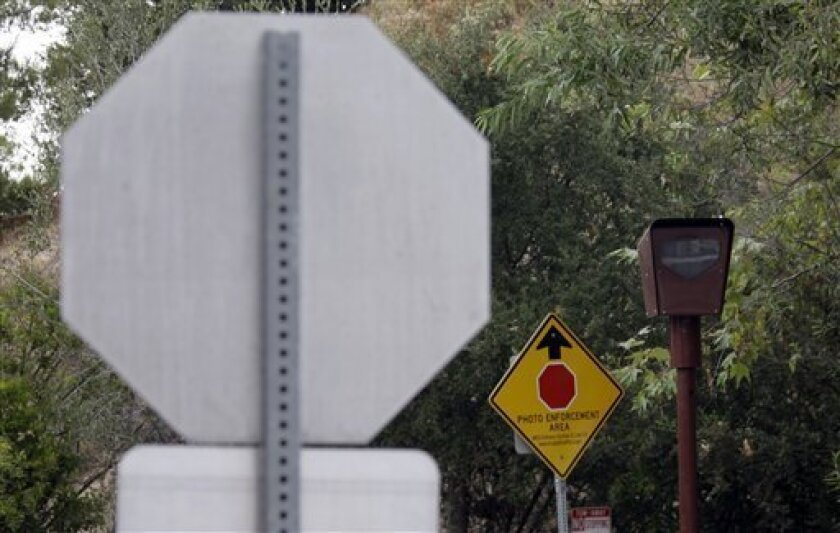 This photo taken Sept. 28, 2010 shows a photo-enforced stop sign camera at the Top Of Topanga overlook in Topanga, Calif. Traffic cameras have increasingly stirred controversy as cash-strapped cities rely on them to enforce rules of the road. Proponents say the cameras are a valuable tool for protecting public safety at a time when police departments are stretched thin, though their effectiveness has been questioned. (AP Photo/Reed Saxon)