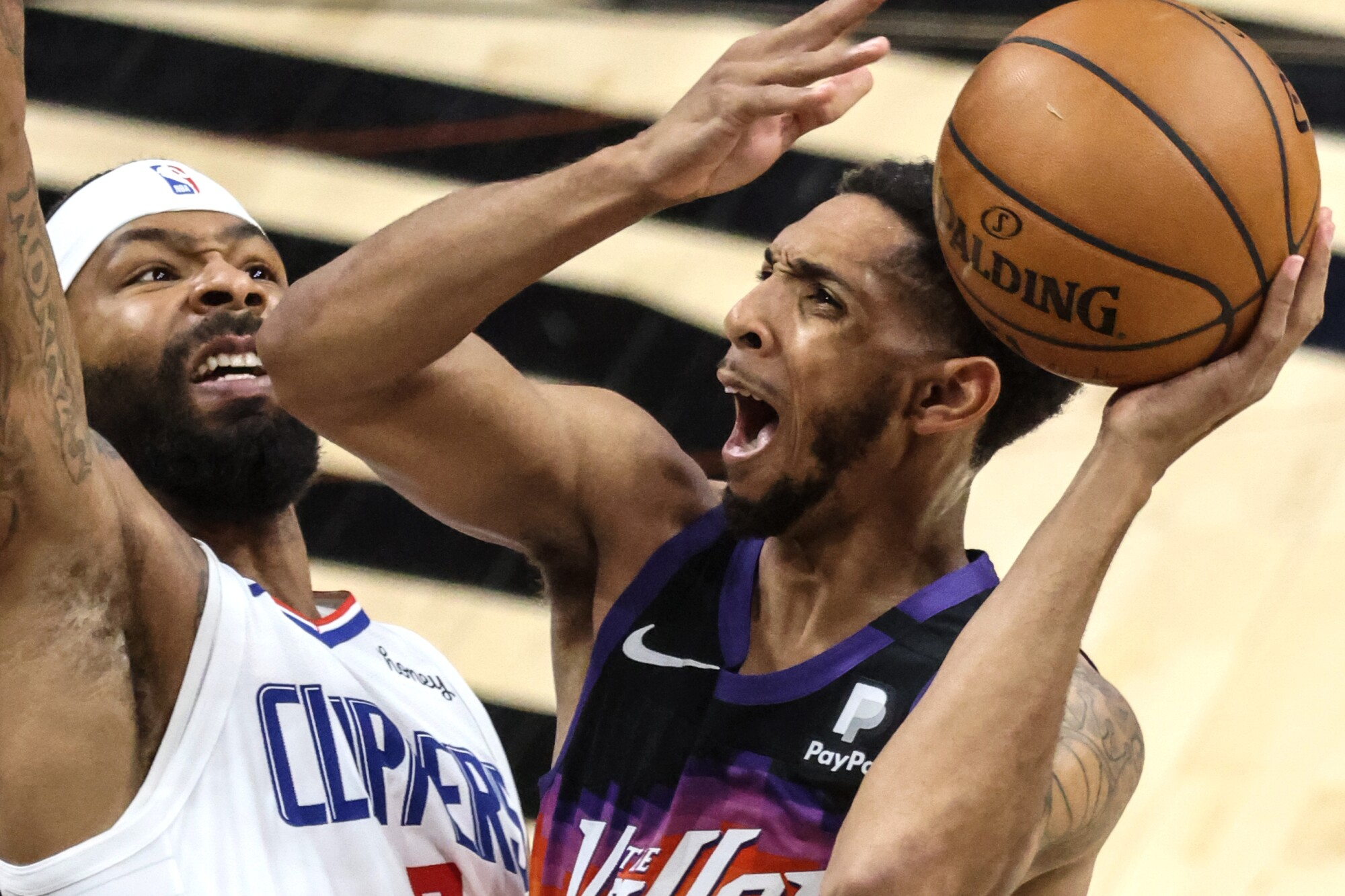 Suns guard Cameron Payne tries to score against Clippers forward Marcus Morris Sr. in Game 2.