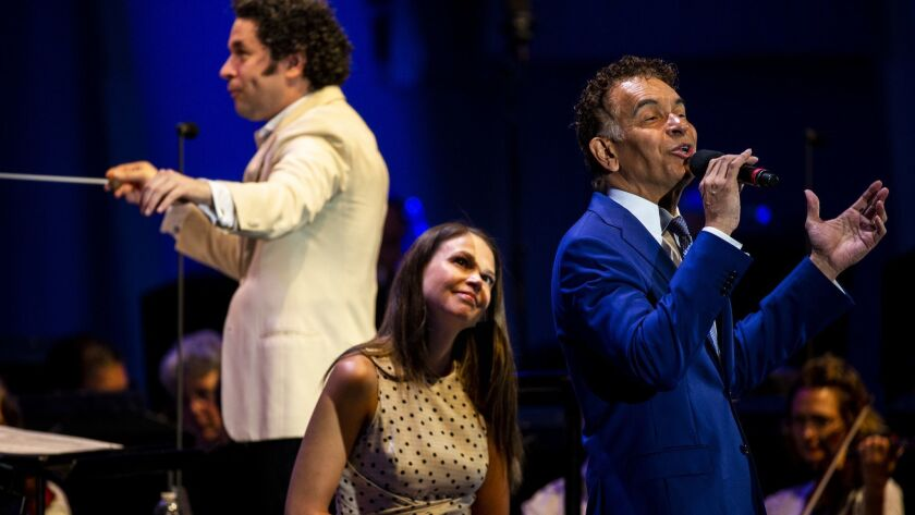 Conductor Gustavo Dudamel, from left, and singers Sutton Foster and Brian Stokes Mitchell in the Los Angeles Philharmonic's Bernstein program at the Hollywood Bowl Tuesday night