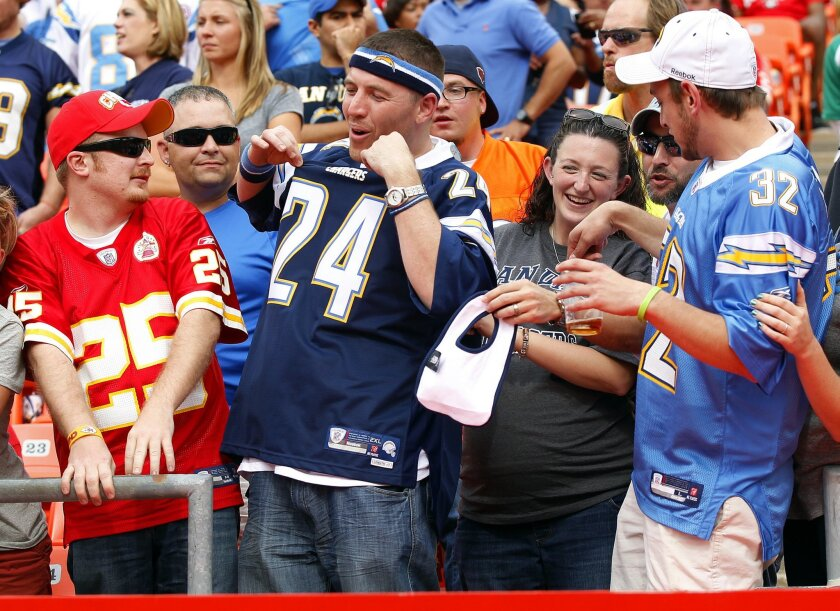 Chargers fans celebrate a win against the Chiefs on Sunday, Sept. 30, 2012.
