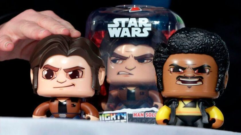 The Star Wars Hans Solo Mighty Muggs, by Hasbro, are demonstrated April 26, 2018, at a toy fair in New York. Hasbro on Oct. 22 reported third-quarter results that fell well short of Wall Street expectations.