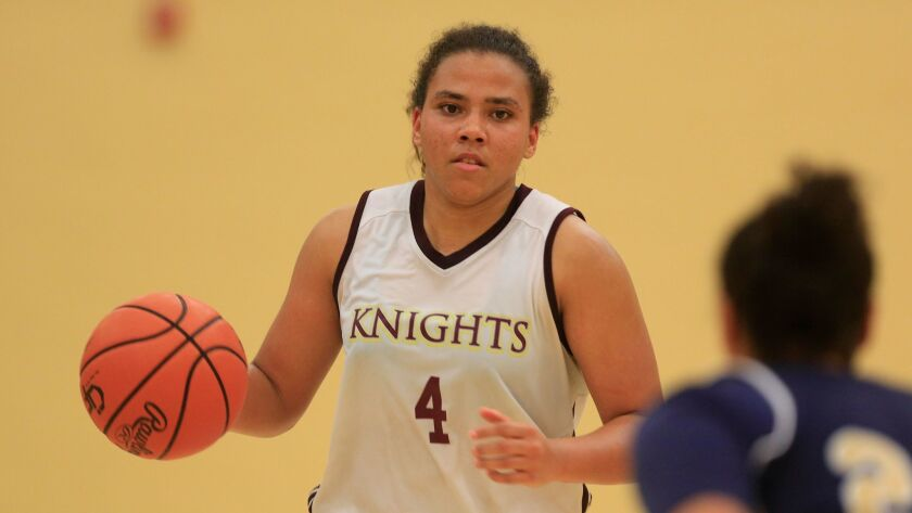 Destiny Littleton of Bishop's is 904 points shy of breaking Charde Houston's state and section career scoring records.