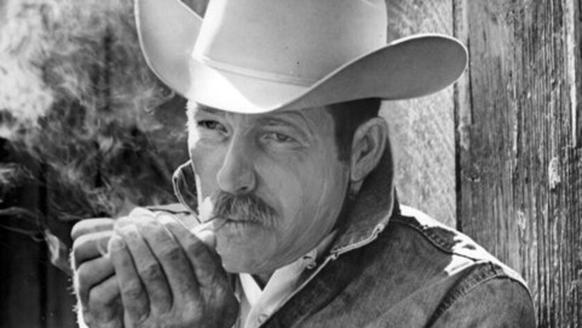 In this 1975 file photo, Darrell Winfield is seen lighting up. Winfield, who played one of the Marlboro Men, was a real cowboy.