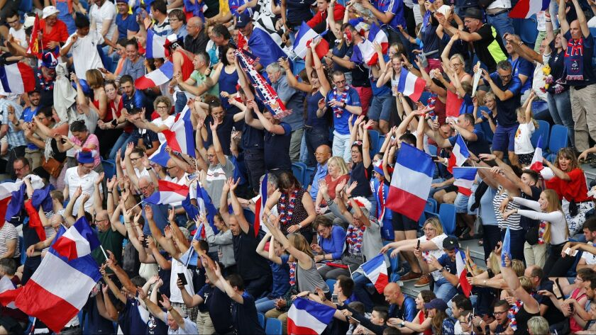 French fans support their team before the Women's World Cup round of 16 soccer match between France