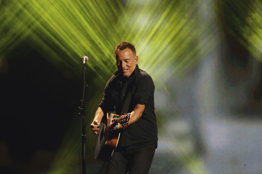"""FILE - Bruce Springsteen performs during the closing ceremonies of the Invictus Games in Toronto on Sept. 30, 2017. Springsteen's latest album, """"Letter To You"""" will be released on Oct. 23. (Nathan Denette/The Canadian Press via AP, File)"""