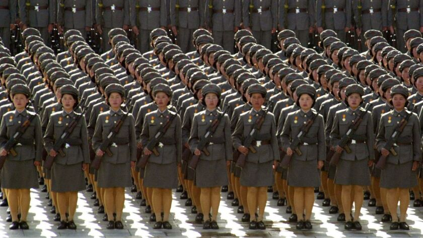 FILE - In this April 25, 2002, file photo, North Korean women soldiers toting rifles stand at attent