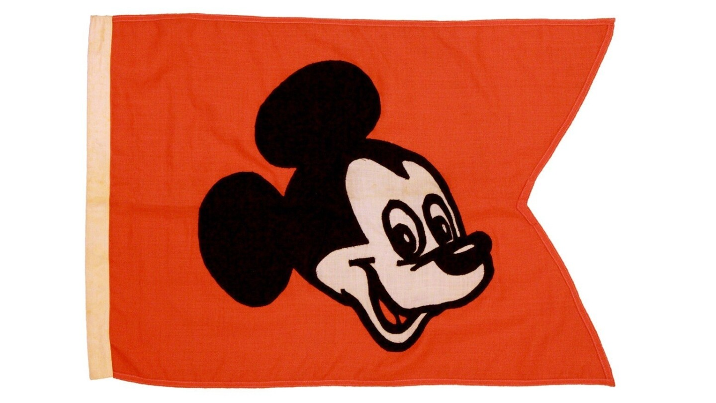 More than 1,000 items from the early days of Disneyland are slated to go to auction in February during the theme park's 60th year. This early flag bears Mickey Mouse's face.