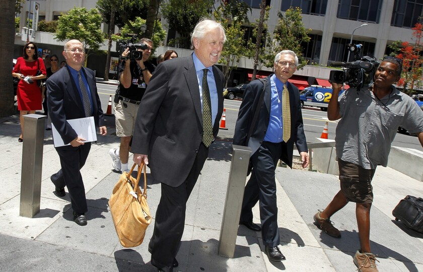 Pierce O'Donnell, center, arrives in June for a pretrial hearing in downtown L.A. in Shelly Sterling's bid to sell the Clippers over the objections of her husband and team co-owner, Donald Sterling.