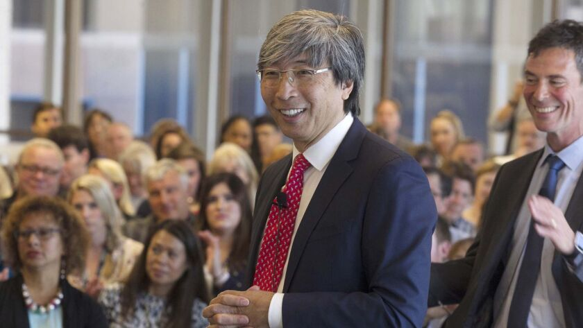 Dr. Patrick Soon-Shiong, who is close to finalizing a deal to buy the San Diego Union-Tribune and the Los Angeles Times, visited the newsroom of the San Diego paper on Monday, At right is U-T editor and publisher Jeff Light.