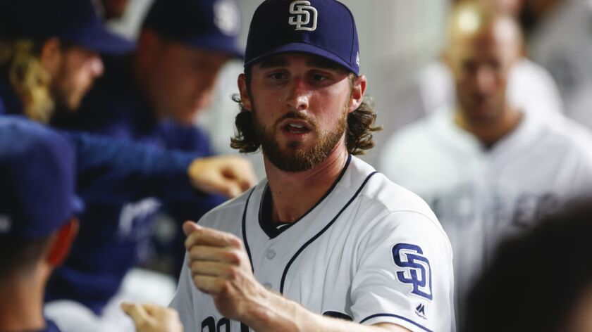Padres starting pitcher Bryan Mitchell fist bumps teammates after the third inning against the San Francisco Giants on Sept. 17, 2018.