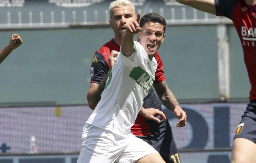 Sassuolo's Giacomo Raspadori celebrates after scoring during the Serie A soccer match between Genoa and Sassuolo, at the Luigi Ferraris stadium in Genoa, Italy, Sunday, May 9, 2021. (Tano Pecoraro/LaPresse via AP)