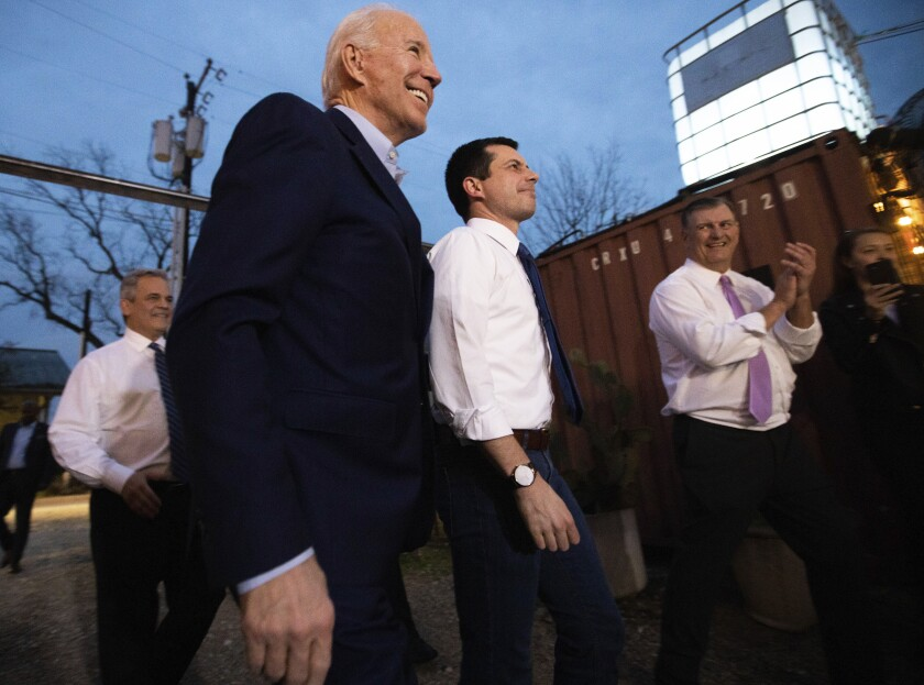 Democratic presidential primary candidate, former Vice President Joe Biden, center left, participates in an event at the Chicken Scratch restaurant the night before Super Tuesday primary voting, on Monday night March 2, 2020 in Dallas. Former Democratic presidential primary candidate Pete Buttigieg, right, was there to endorse Biden after he stopped his campaign Sunday. (Juan Figueroa/The Dallas Morning News via AP)