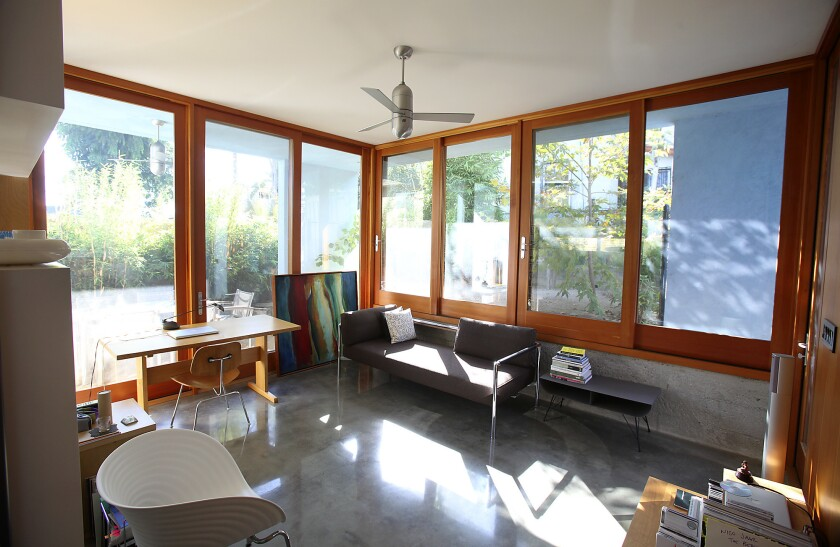 """The doors and windows from Taylor Brothers Architectural Products in Los Angeles cost about $25,000, a splurge justified by the welcome sense of openness they provide. """"We kept cost in mind to know when to spend and when not to,"""" designer Molina says."""